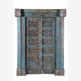 Porte bleue sculptée en bois avec cadre solide